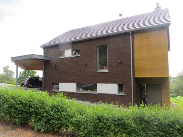 Maison brique brune et bardage cèdre - Architecture & Bois