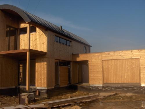 Maison ossature bois avec toiture cintr e architecture bois - Probleme maison ossature bois ...